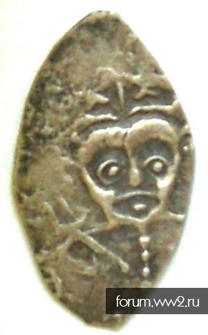 Монета похожая на чешуйку