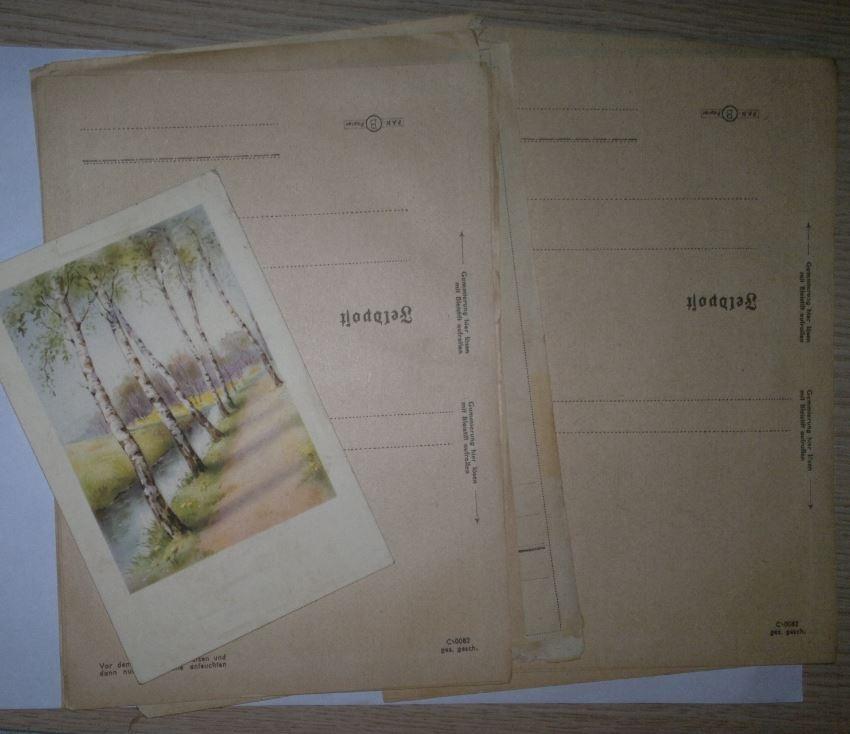 пара десятков чистых бланков для писем и открытка письмо