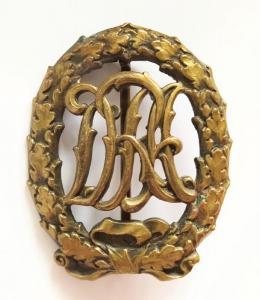 Знак DRA в бронзе